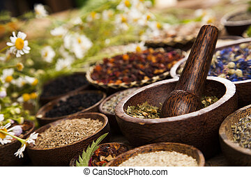 Natural remedy, Herbal medicine and wooden table background...