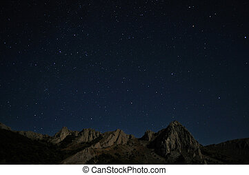 Natural rocks and stars at night in the mountains