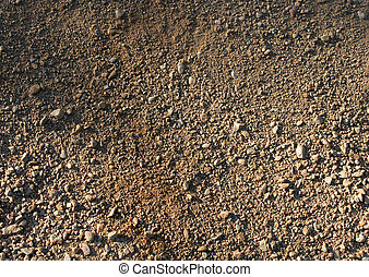 Natural brown rough sand gravel small stones background