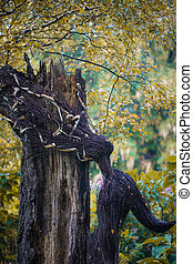 Natural sculpture made from tree branches associated with autumn coming
