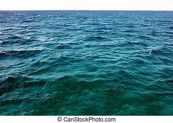 Natural sea water surface - natural greenish blue seawater...