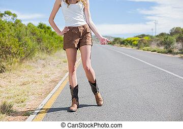 Natural slim woman hitchhiking
