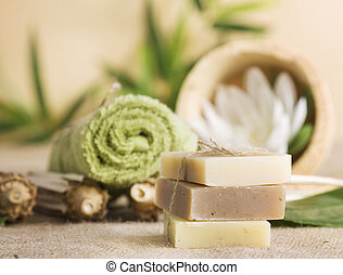 Natural soaps - Spa setting with natural soaps and lotus...