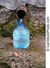 Natural source of water and plastic bottle