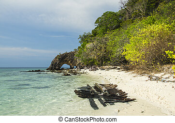 Natural stone arch with beautiful beach at Kho Khai near Tarutao national park and Koh Lipe in Satun, Thailand