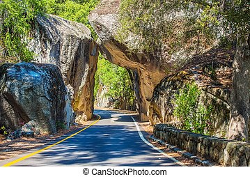 Natural Stone Bridge and the Road Through Sierra Nevada...
