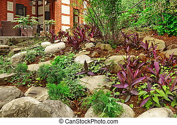 Natural Stone Landscaping. Backyard Decorative Garden. House Terrace With Furniture