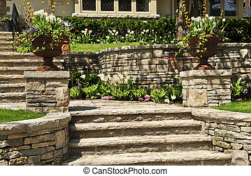 Natural stone landscaping in front of a house