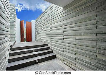 Natural stone wall and staircase in luxury villa