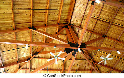 A natural wood ceiling pavillion with ceiling fans