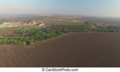 Nature aerial view. Endless plowed fields to the horizon