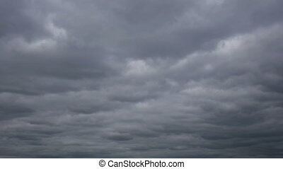 Nature background Ominous clouds drift slowly across the sky, threatening rain. FHD stock footage.