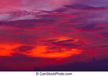 Nature background. Red sky at night and clouds. Beautiful and colorful sunset time.