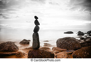 Nature background. Sea dramatic landscape, harmony environment and zen stones tower silhouette. Meditation photography
