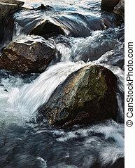 Wild water between stones