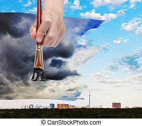 paintbrush paints black storm clouds over city