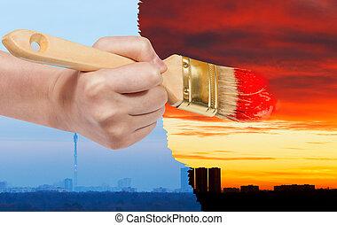 paintbrush paints red sunset on blue sunrise