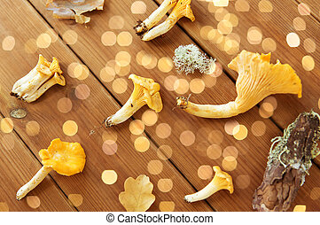 chanterelles on wooden background - nature, environment and ...