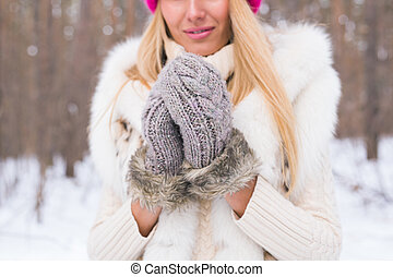 Nature, fashion and people concept - Close up portrait of beautiful young woman in winter park with snow