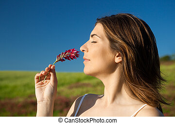 Nature fragrance - Beautiful young woman feeling the smell ...
