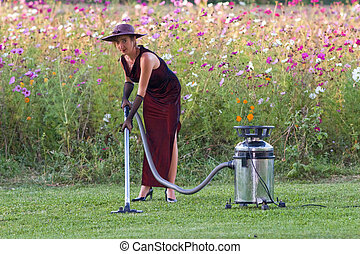 woman cleaning natural green carpet in wild floral landscape