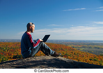 Nature laptop - getting away from it all on the laptop in...