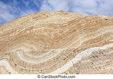 Striped rock texture on a hill.