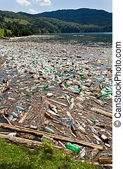 beautiful landscape ruined by trash pollution, Bicaz lake, Romania