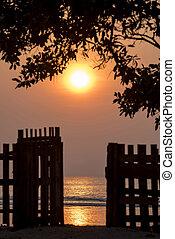 Nature scenery with sunset on summer beach coast