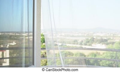 Nature view through the window. Easy swaying of tulle from the wind. High key. Overexposure. High quality 4k footage