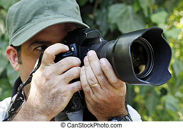Nature Wildlife Photographer - A photographer is holding a ...