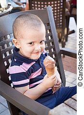 Naughty toddler eating ice cream
