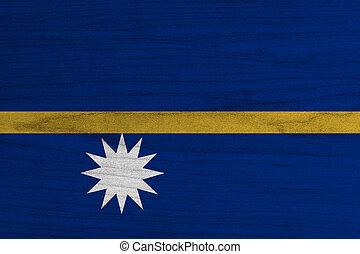 Nauru Flag painted on old wood background