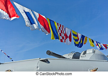 Nautical flags against blue sky - Nautical flags and cannon ...