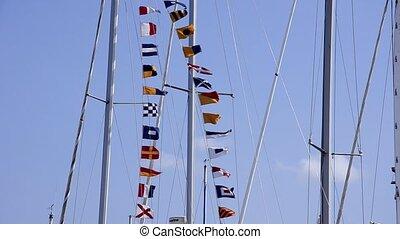 nautical flags - Nautical flags waving. Blue sky. Summer....