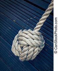 Nautical knot on blue background