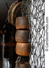 Nautical theme of fishing net, buoys and antique fishing wooden reel