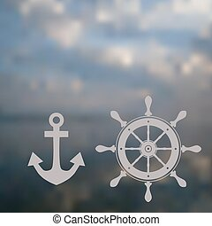 nautical wheel and anchor in soft background