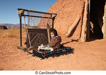 Navajo Child Sitting Next to Traditional Rug Making Tools