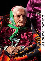Navajo Elder Wearing Traditional Turquiose Jewelry With...