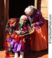 Navajo Family of 2 Women in Front of Traditional Hogan