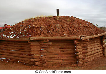 Exterior of Navajo hogan, traditional dwellings of the Navajo in the American Southwest.