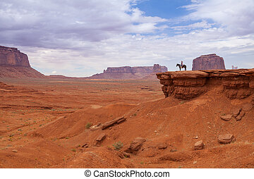 Navajo Horsewoman Monument Valley