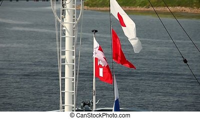 Naval flags - signal flags in the wind