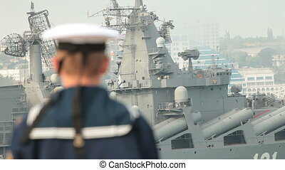 Naval forces - Russian sailor, in the background moored...