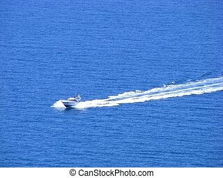 Naval motorboat floats on the high seas clear sunny day