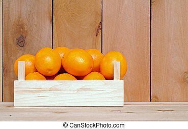 naval orange fruit in crate on wooden background