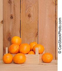 naval orange fruit in crate on wooden shelf