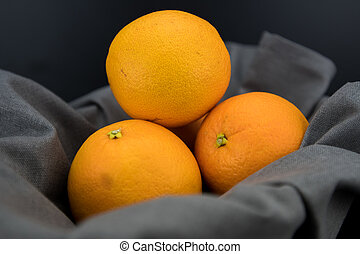 Naval Oranges in Bowl lined with gray linen napkin