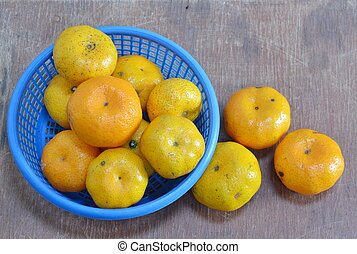 navel orange on blue basket